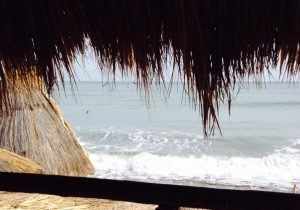 Palm roof rancho on remote ocean beach